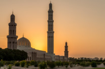 sultan qaboos grand mosque at sunset